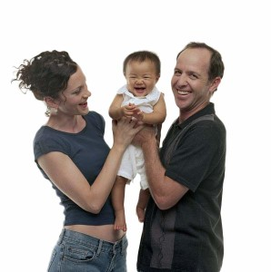 Parents-Holding-Baby-White